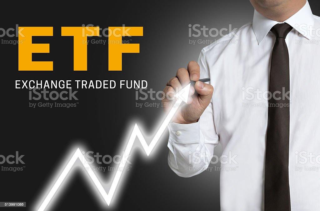 etf trader draws market price on touchscreen stock photo
