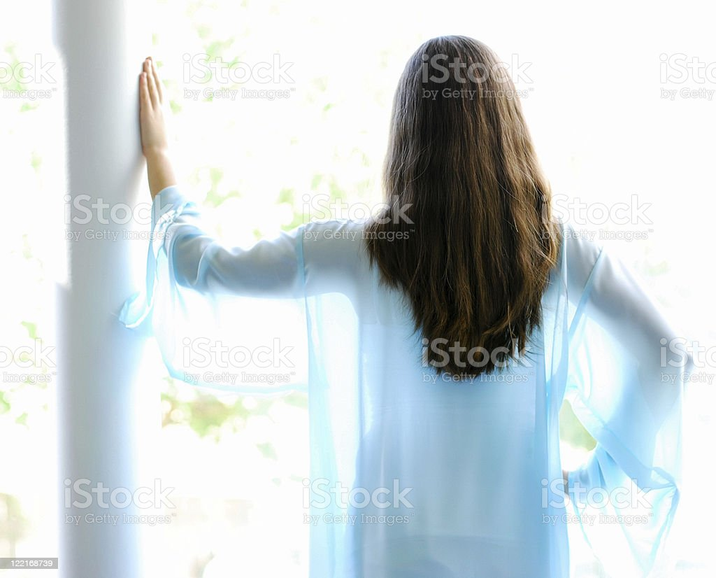 Ethereal Image Back of Young Woman with Long Hair stock photo
