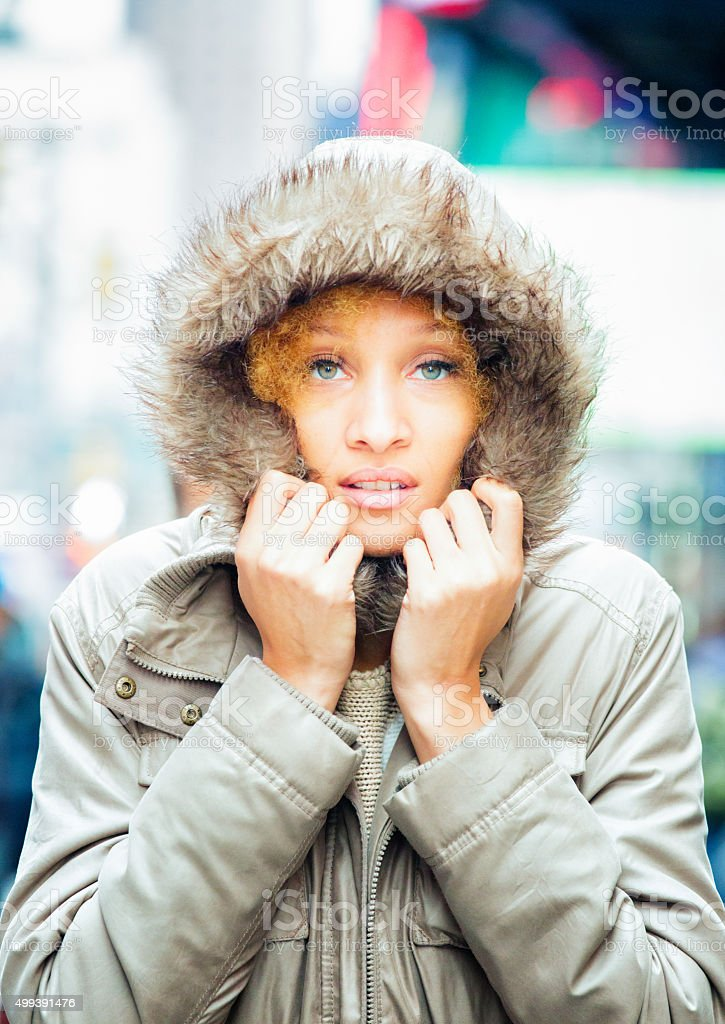 Ethereal mixed-race woman in Winter coat stock photo