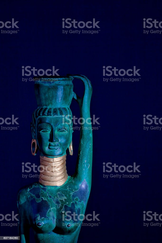Ethic art statue of a tribal giraffe woman stock photo