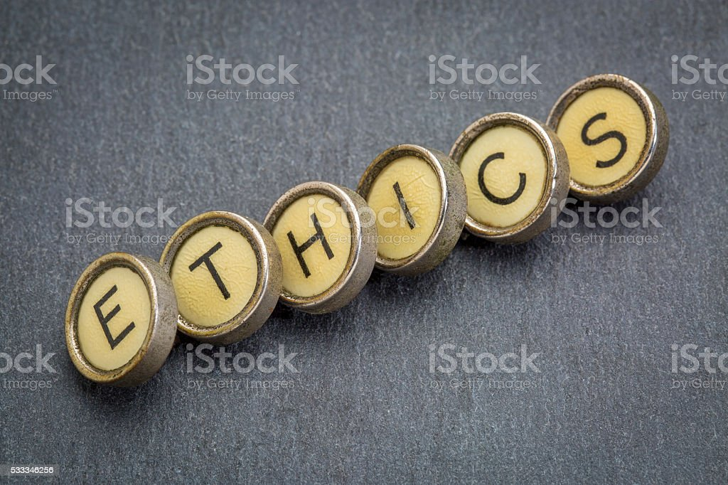 ethics word in  typewriter keys stock photo