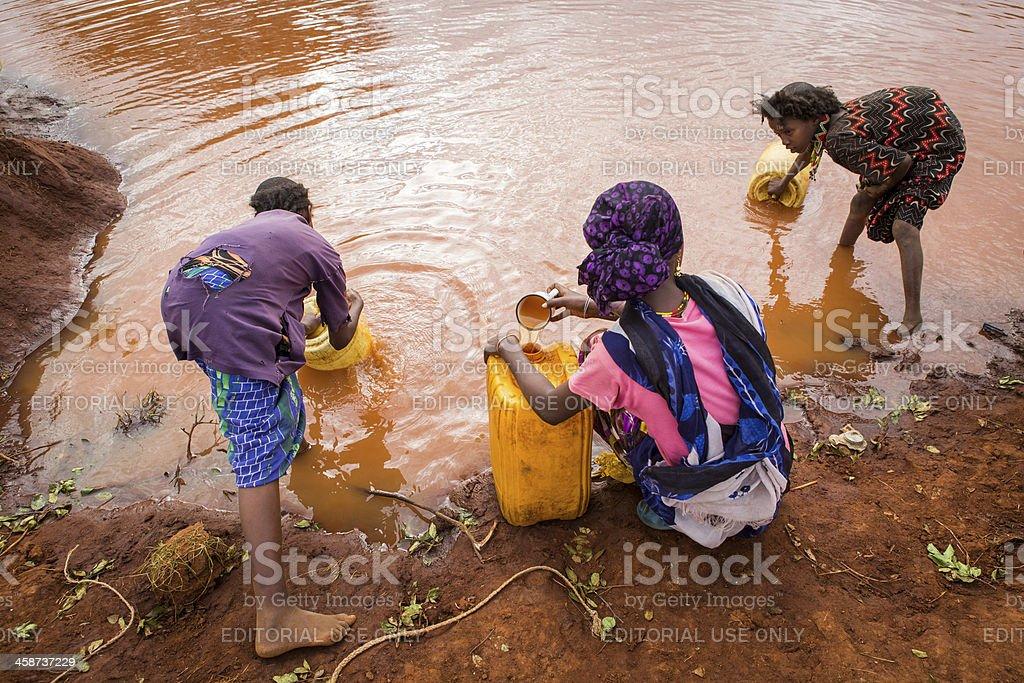 Ethiopian girls collect rain water royalty-free stock photo