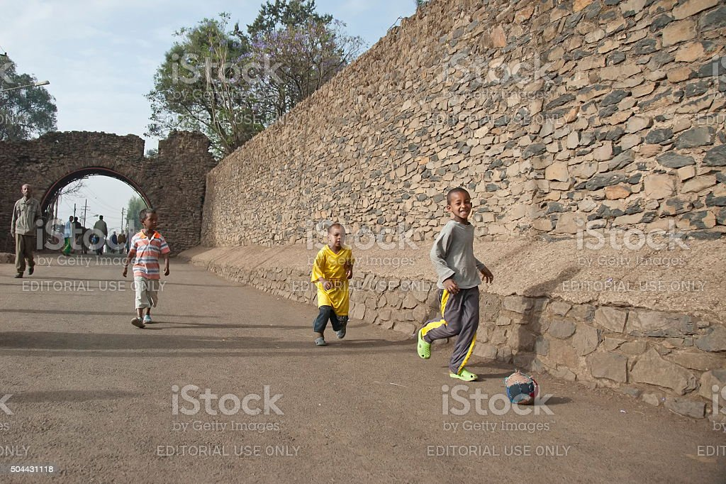 Ethiopian kids play soccer with hand made ball, Gondar, Ethiopia. stock photo
