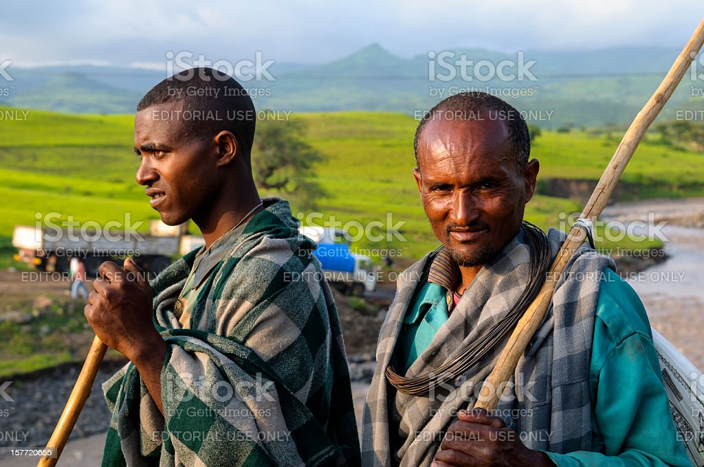 Ethiopian men and green landscape royalty-free stock photo