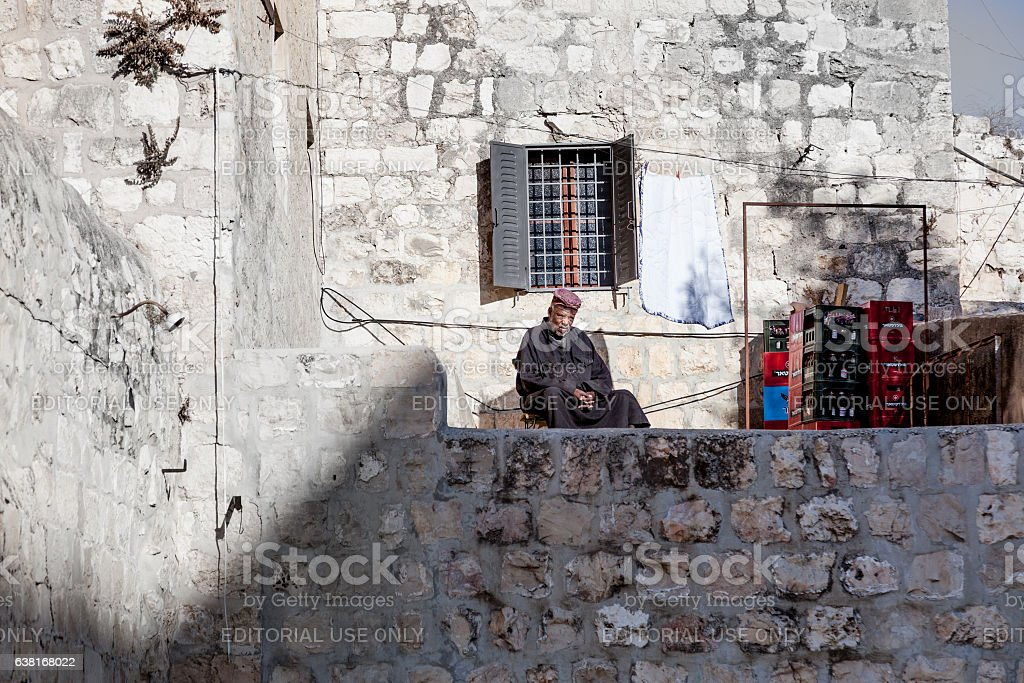 Ethiopian monk atop the Church of the Holy Sepulchre stock photo