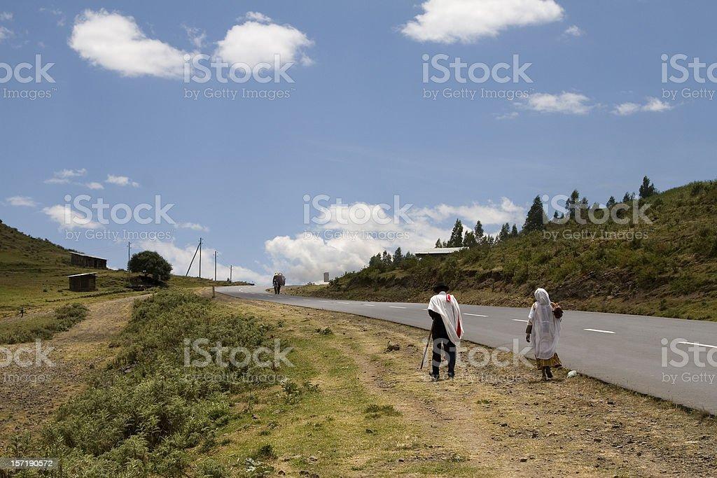 Ethiopian people walking along the road stock photo