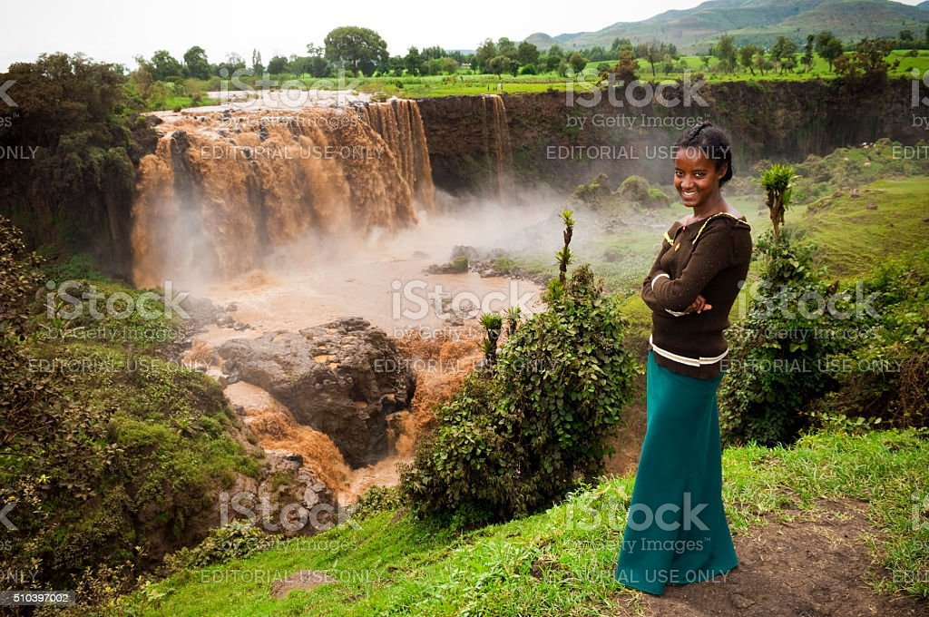 Ethiopian teenager at Blue Nile Falls in Tis Abay stock photo