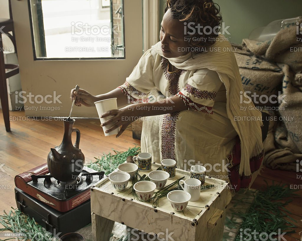 Ethiopian woman serving coffee stock photo