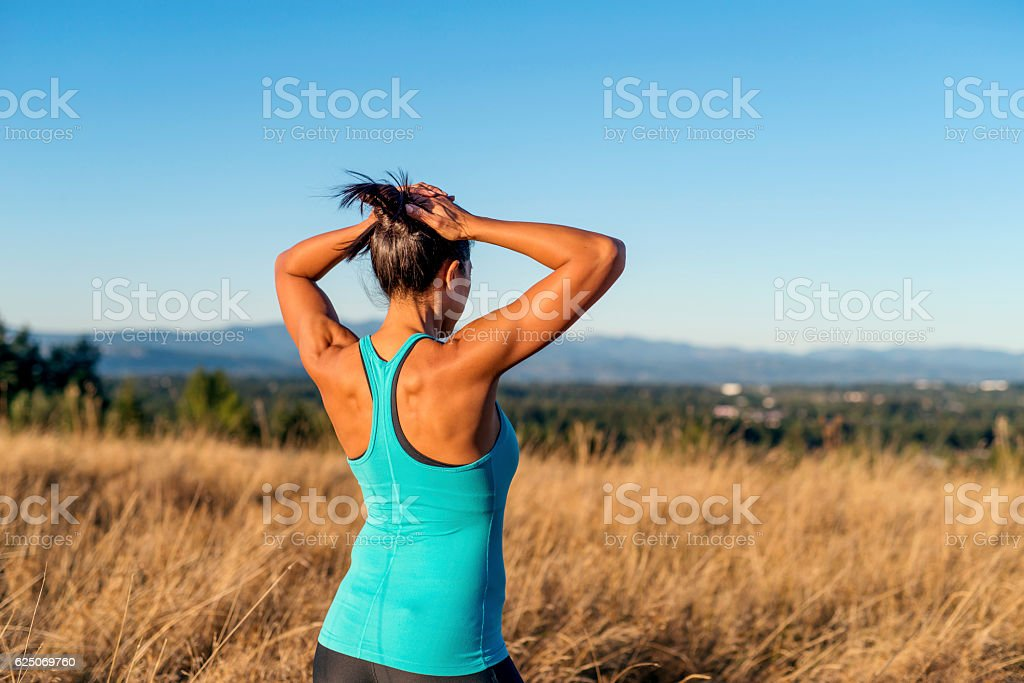 Ethnic adult female athlete with hands on her head stock photo