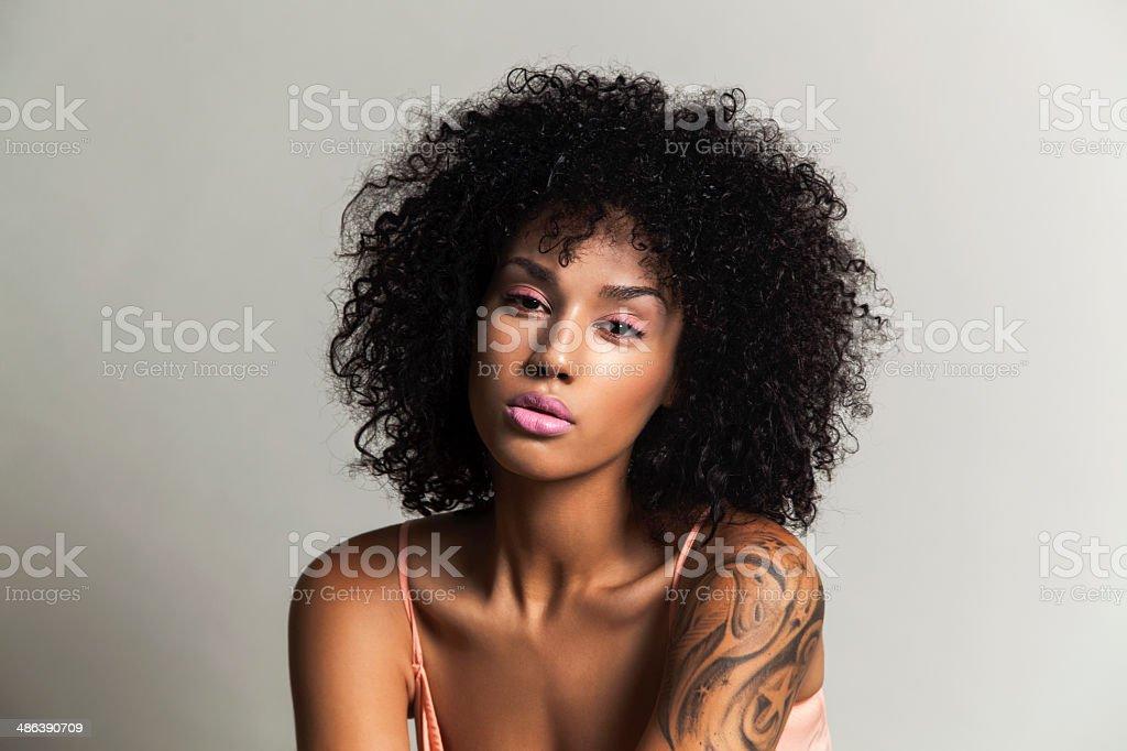 Ethnic beauty with pink eye shadow stock photo
