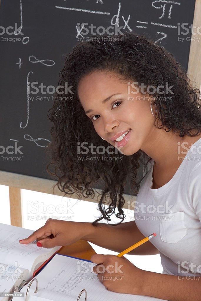 ethnic black college student woman studying math exam stock photo