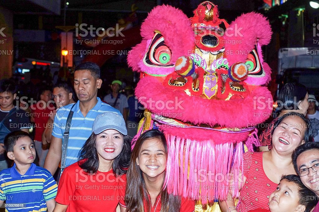 Ethnic Chinese Pose with  Dancing Lion Mascot New Year Decoration stock photo