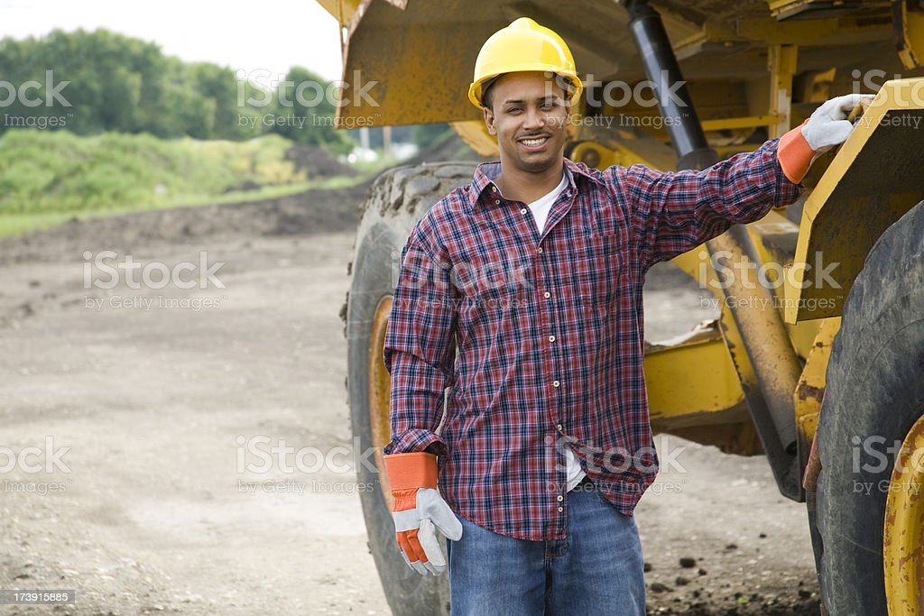ethnic construction worker smiling royalty-free stock photo