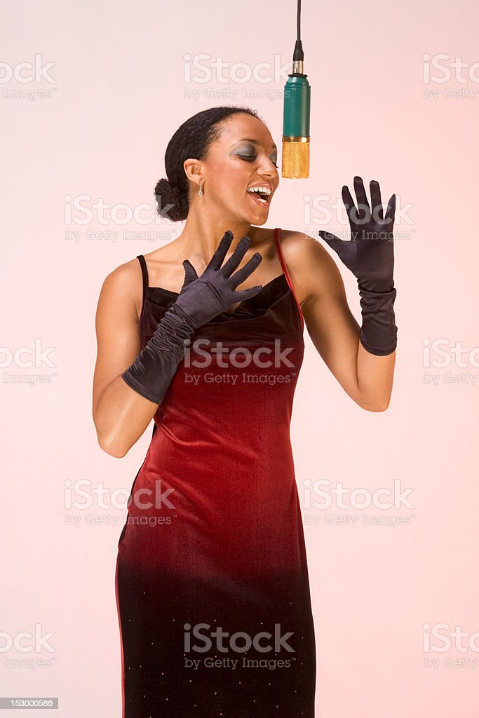 Ethnic diva woman singer in red concert dress stock photo