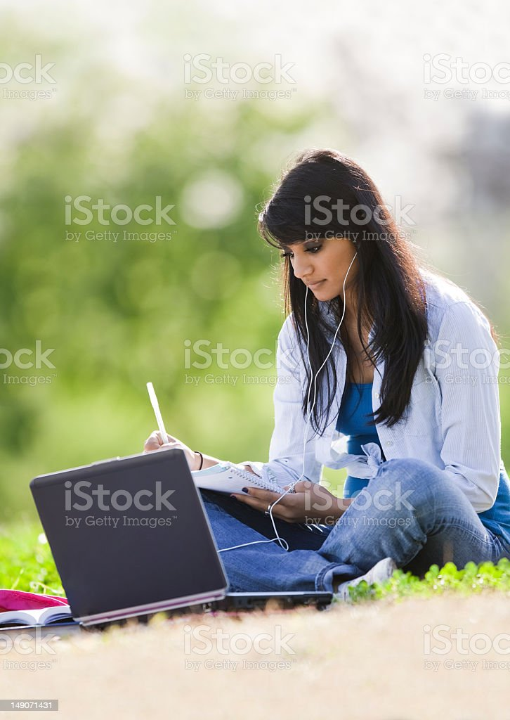 Ethnic Female College Student Studying Outdoors royalty-free stock photo