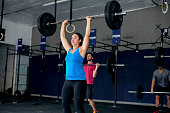 Ethnic female doing an intense gym workout