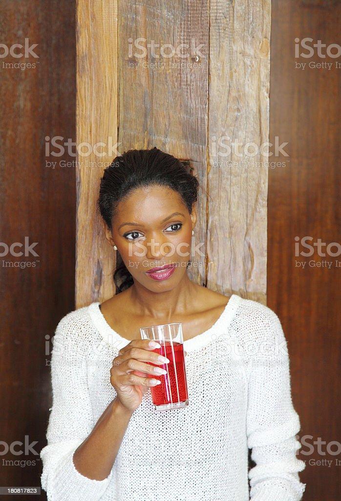 Ethnic female drinking stock photo