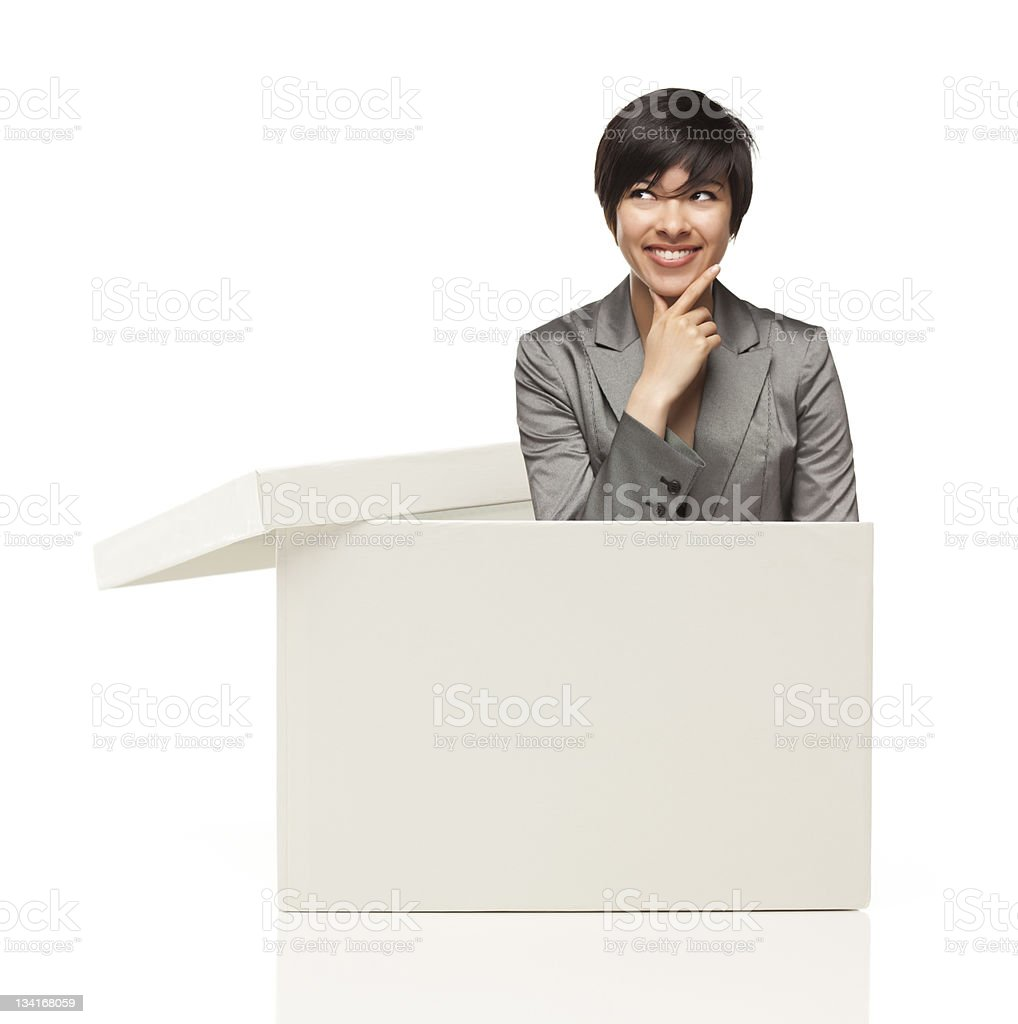 Ethnic Female Popping Out and Thinking Outside The Box stock photo