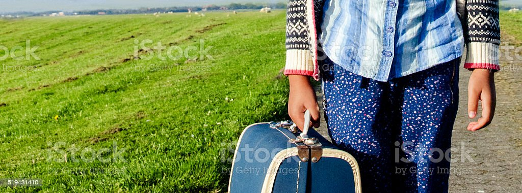 Ethnic Girl travelling alone with her suitcase stock photo
