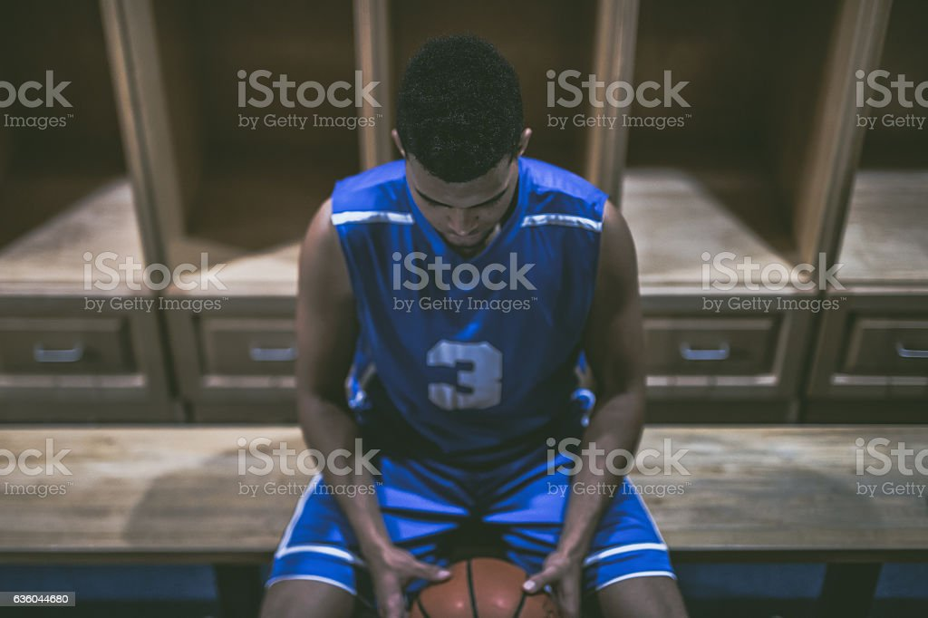 Ethnic high school basketball player mentally preparing for game stock photo