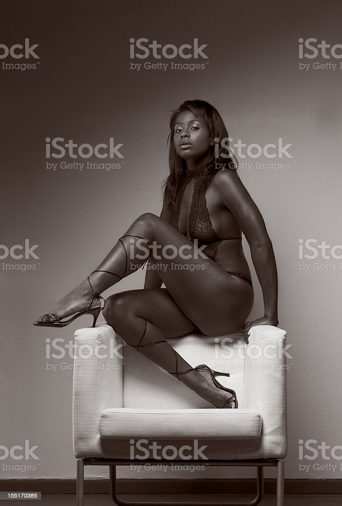 ethnic Latina sensual woman in lingerie on chair royalty-free stock photo