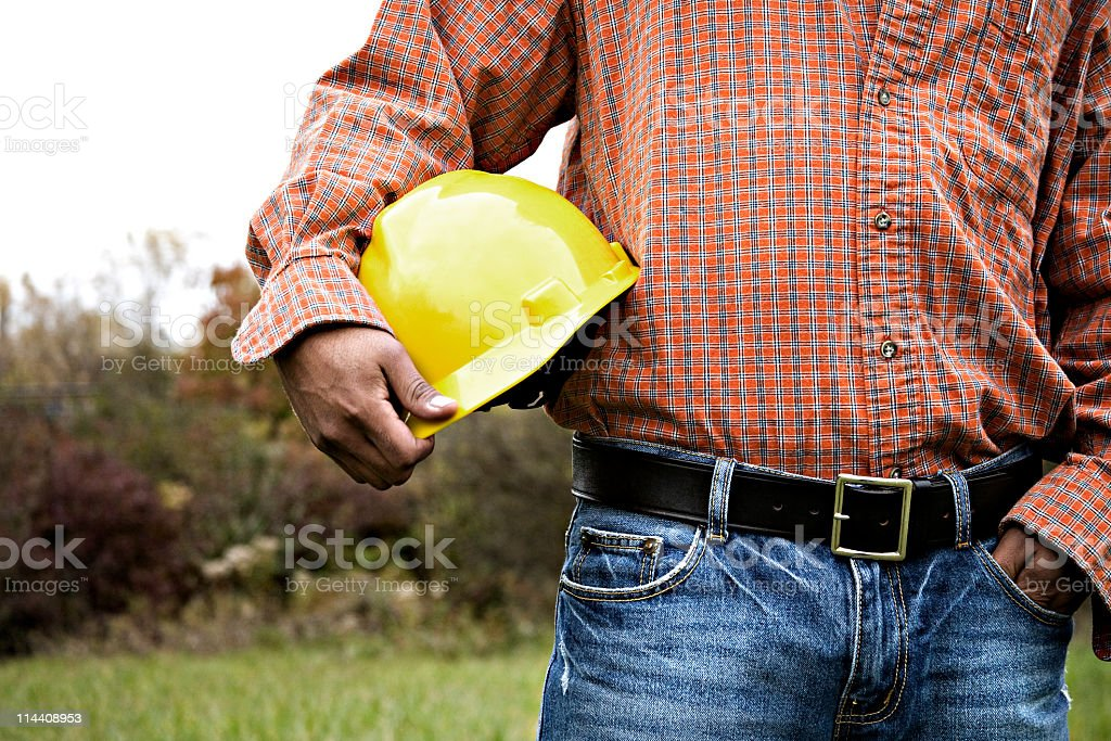 Ethnic man holding construction helmet royalty-free stock photo