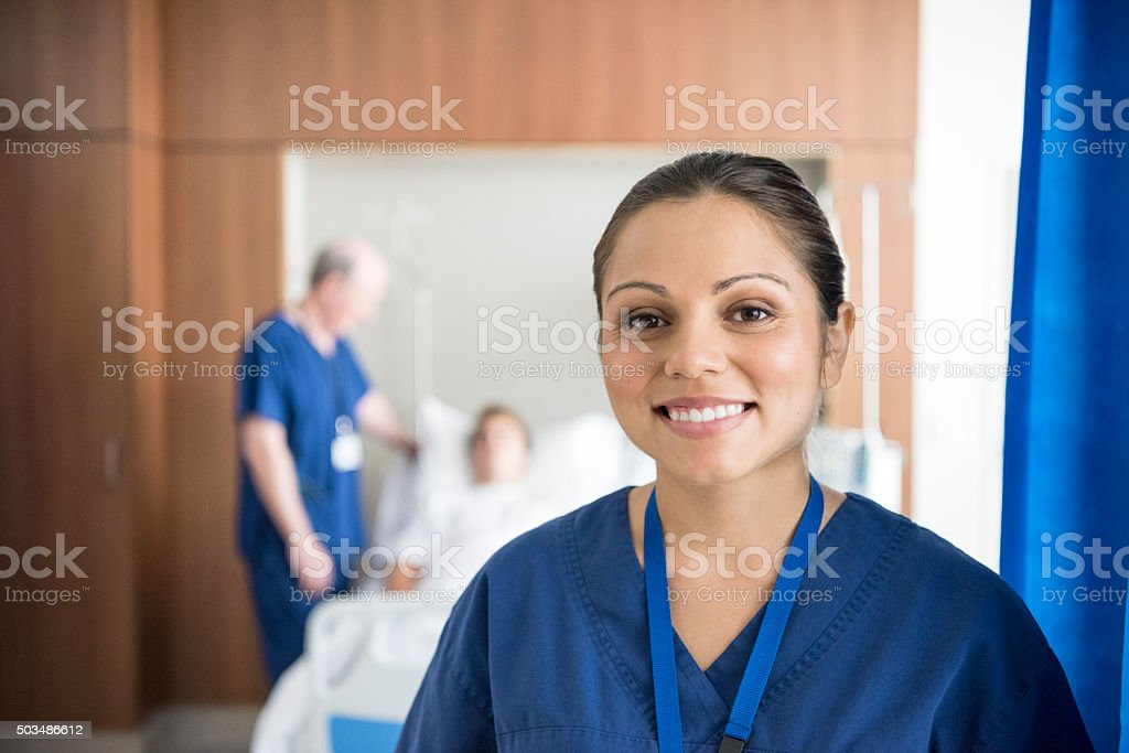 Ethnic nurse on hospital ward smiling to camera, portrait stock photo