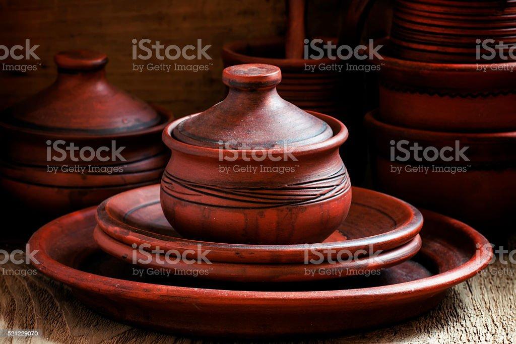 Ethnic pottery, vintage wooden background stock photo
