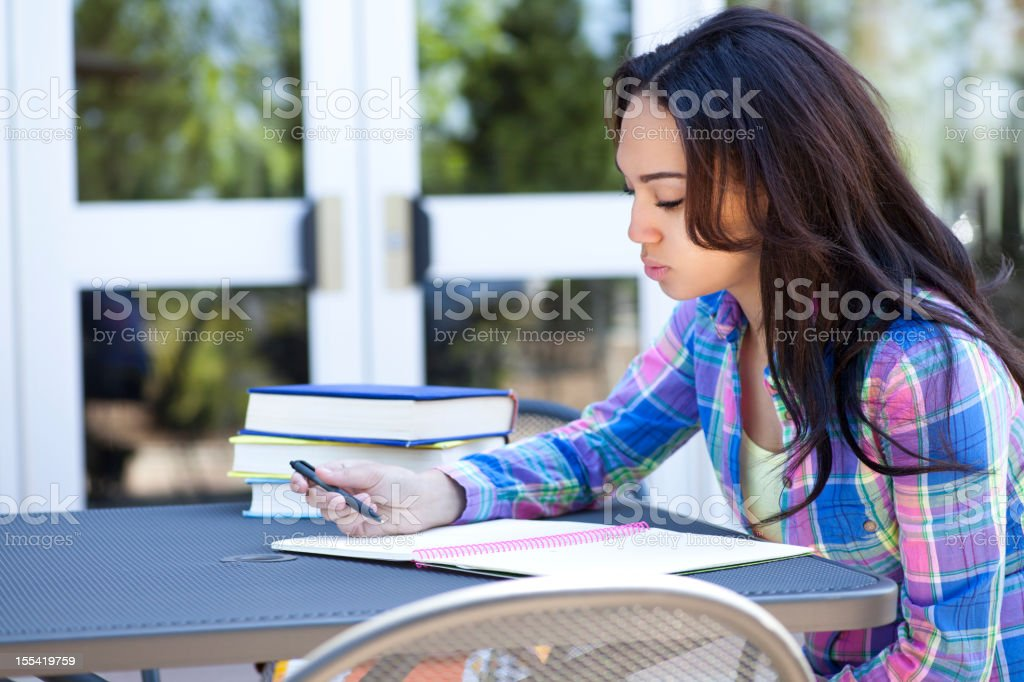 Ethnic student thinking royalty-free stock photo