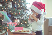 Ethnic toddler girl waiting for santa clause with