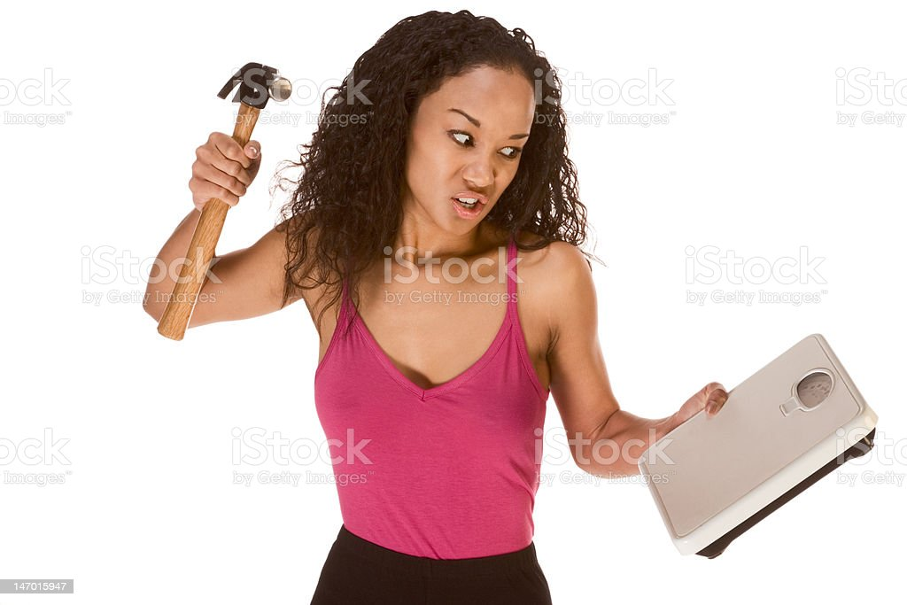 Ethnic woman frustrated by results of her diet stock photo