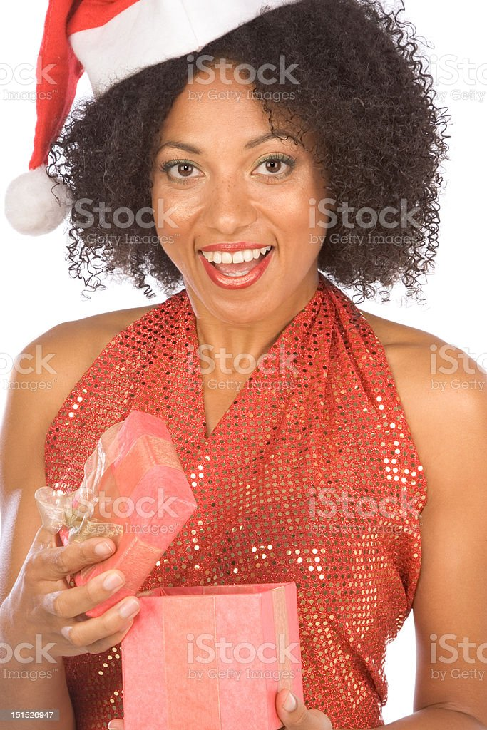 Ethnic woman surprised with Christmas present royalty-free stock photo
