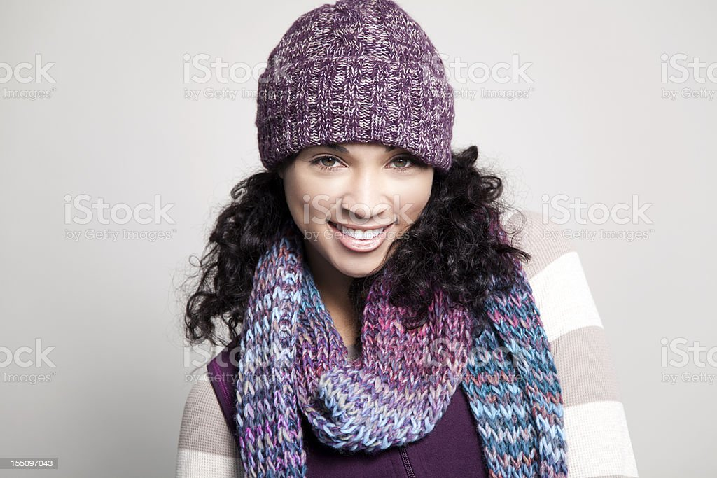 Ethnic woman with hat smiling stock photo