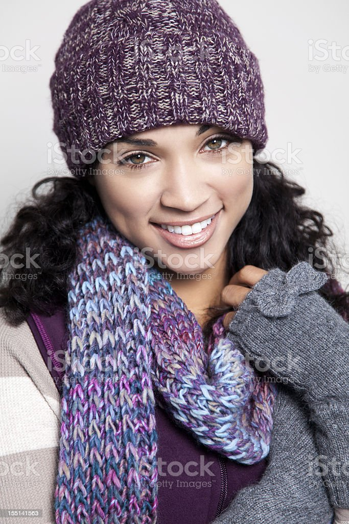 Ethnic woman with hat smiling royalty-free stock photo