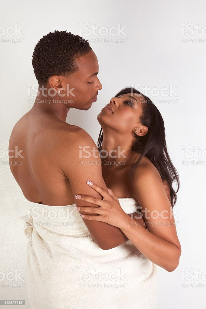 Ethnic young couple wrapped in white bath towel royalty-free stock photo