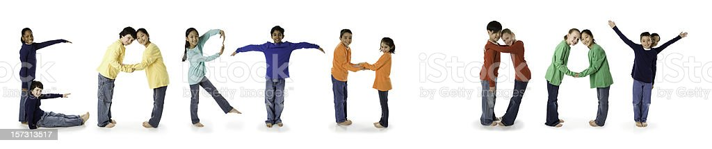 Ethnically Diverse Children Spell Earth Day stock photo