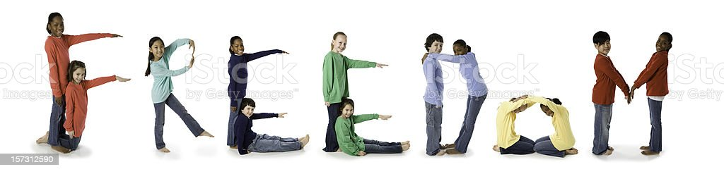 Ethnically Diverse Children Spell Freedom royalty-free stock photo