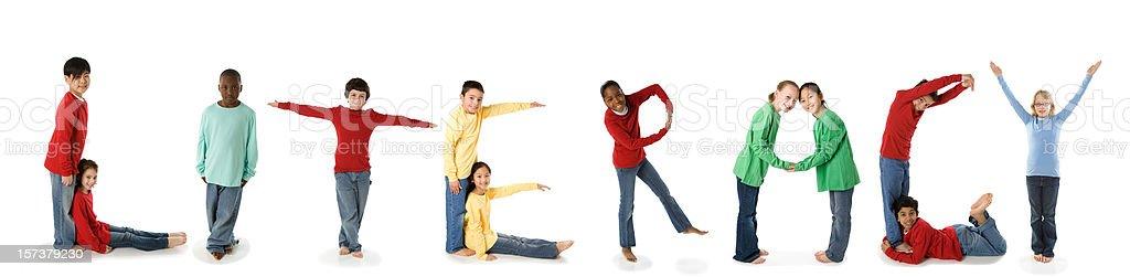 Ethnically Diverse Children Spell Literacy stock photo