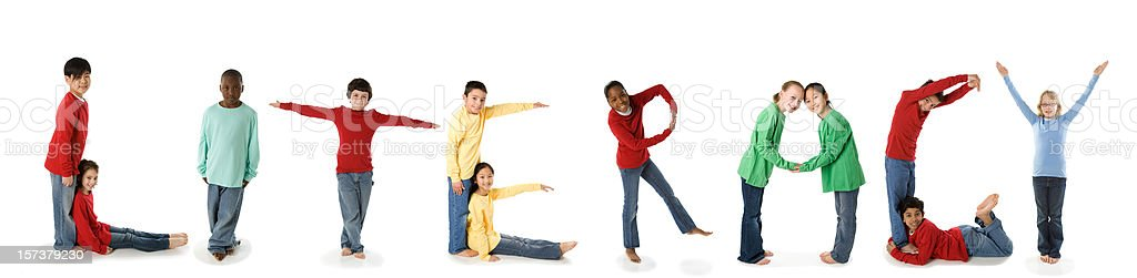 Ethnically Diverse Children Spell Literacy stock photo