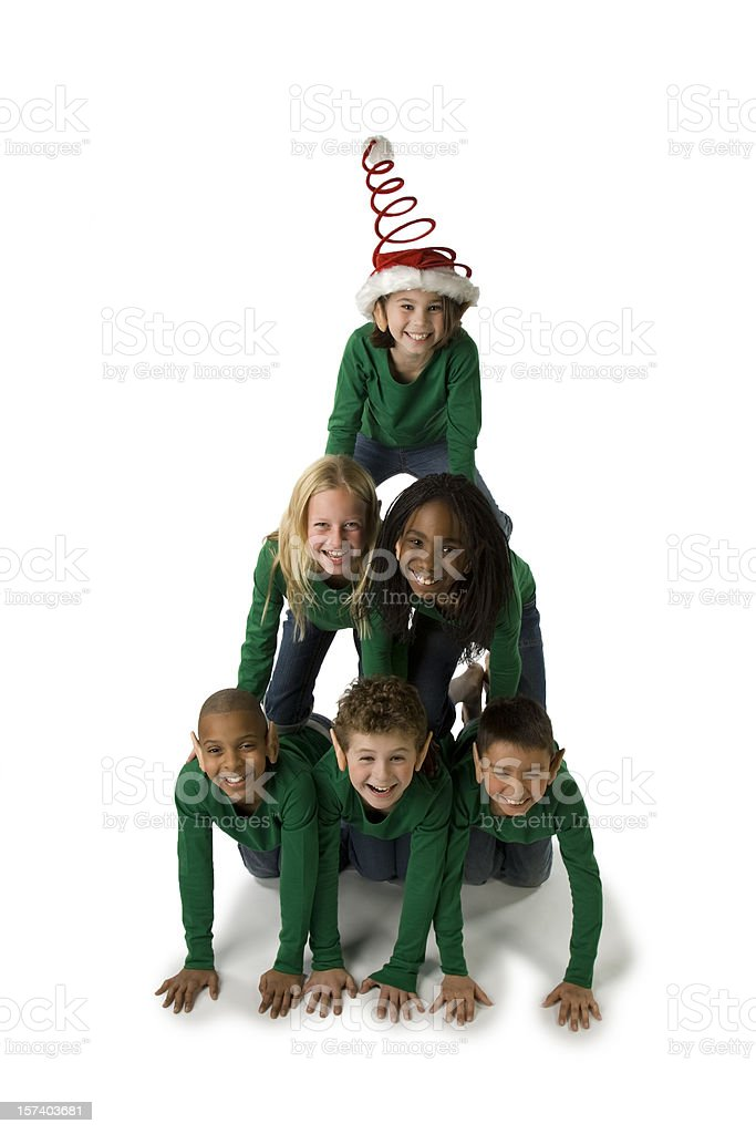 Ethnically Diverse Group of Christmas Elves Make a Pyramid stock photo