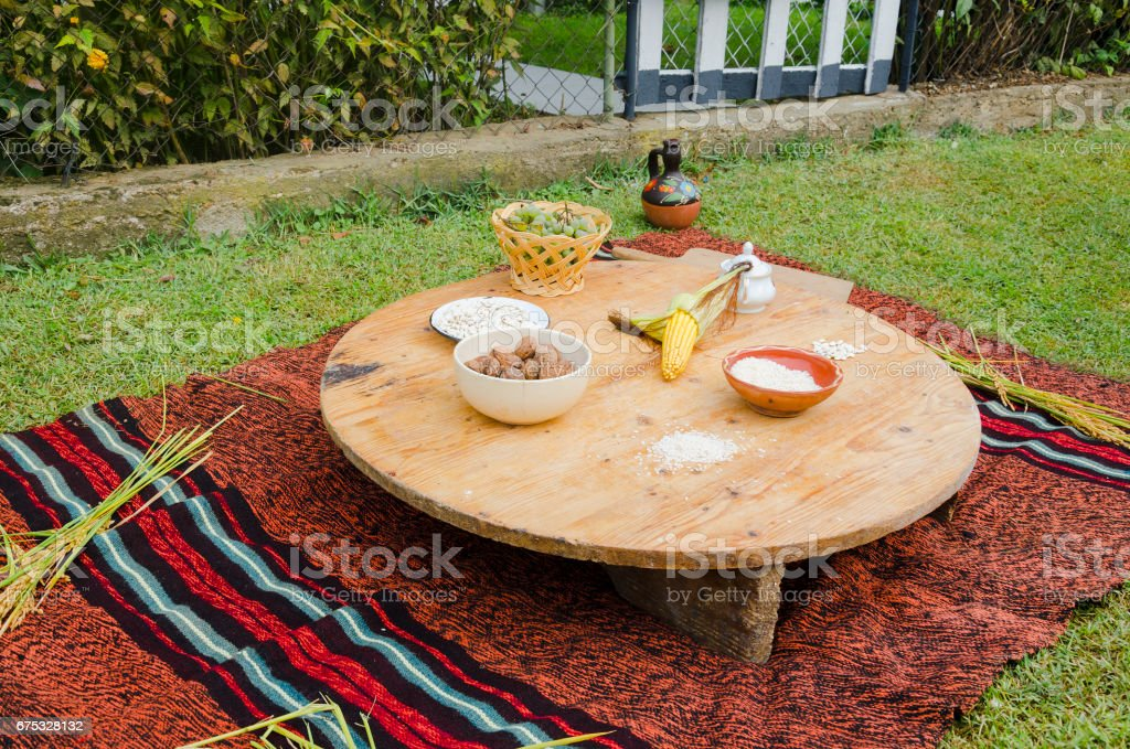 Ethno bag, fruit and vegetables on the wooden circle table