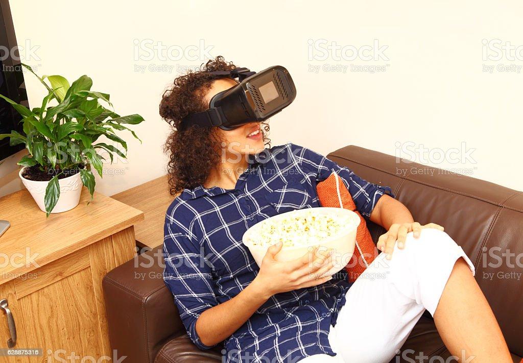 etnic female enjoying her virtual reality headset stock photo