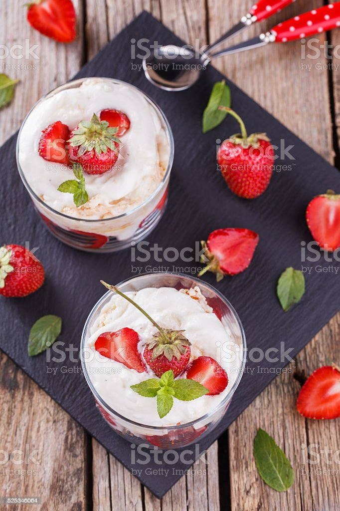 Eton Mess - Strawberries with whipped cream stock photo