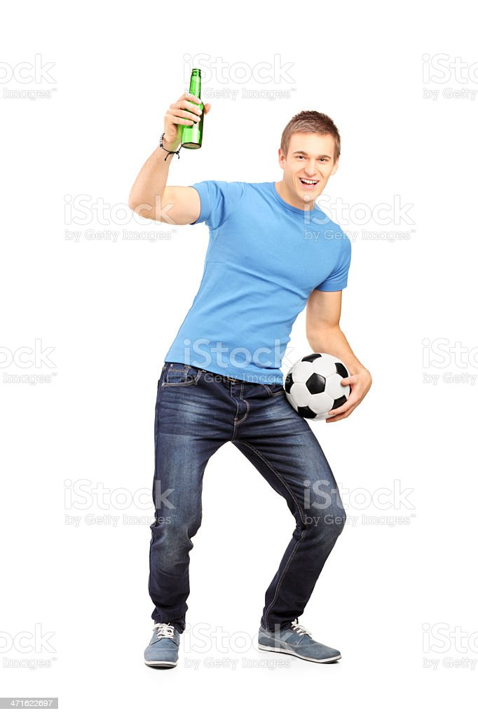 Euphoric fan holding a beer and football royalty-free stock photo