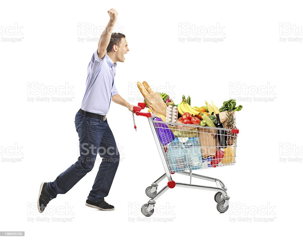 Euphoric man pushing a shopping cart stock photo