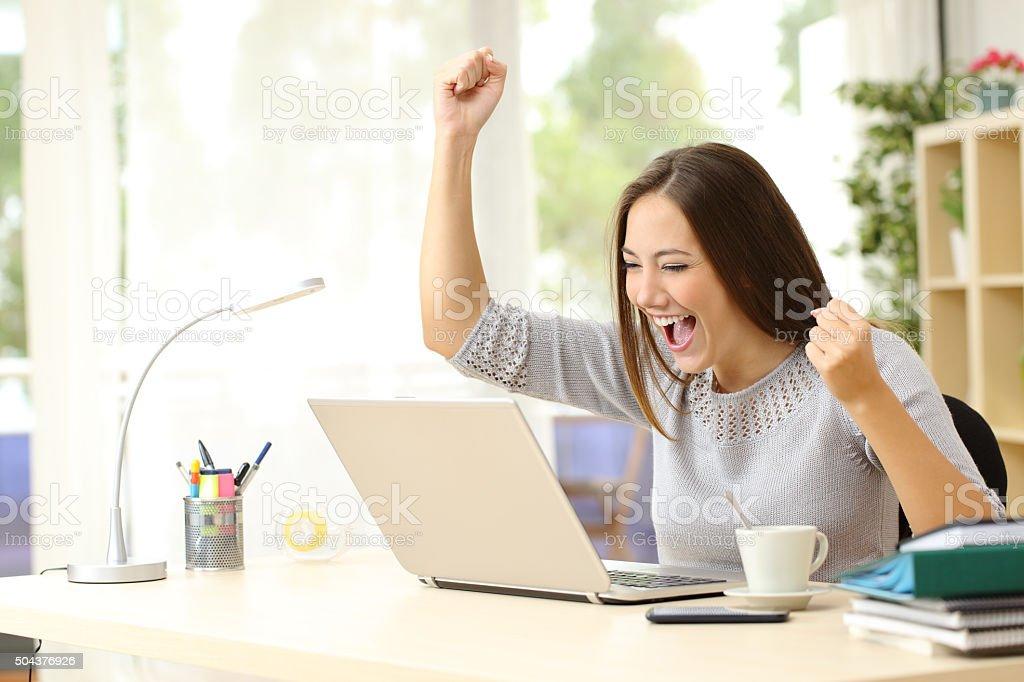 Euphoric winner winning at home stock photo