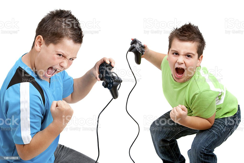 Euphorious boys playing with consoles stock photo
