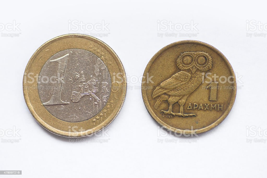 1 euro and 1 drachma coins stock photo