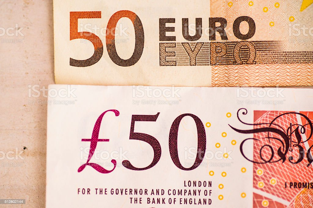 50 euro and 50 british pound stock photo