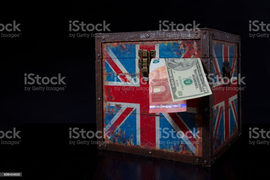 euro and american dollar on British flag stock photo